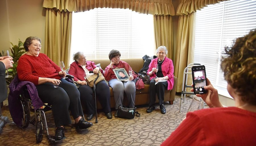 Linda Perucca takes a photo of her mother, Mary Perucca, 85, left, and her three sisters several weeks ago at Travanse Living, an assisted living facility in Grayslake. Mary hadn't seen her sisters since 2015. Linda won a writing contest sponsored by Travanse Living, who brought all three sisters from Indiana for a six-day stay.