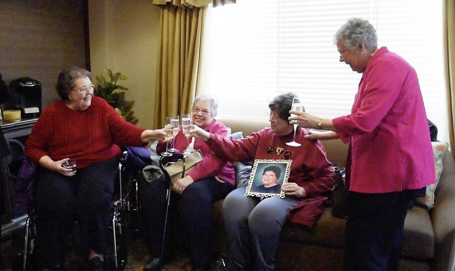 Mary Perucca, 85, left, shares a toast with her three sisters Tuesday at Travanse Living, an assisted living facility in Grayslake. She hasn't seen her sisters since 2015.