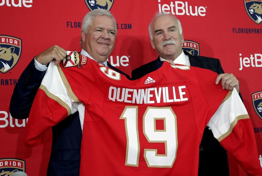 Florida Panthers NHL hockey team General Manager Dale Tallon, left, and Joel Quenneville, right, after Quenneville was introduced Monday as the Florida Panthers new head coach at a news conference in Sunrise, Florida.