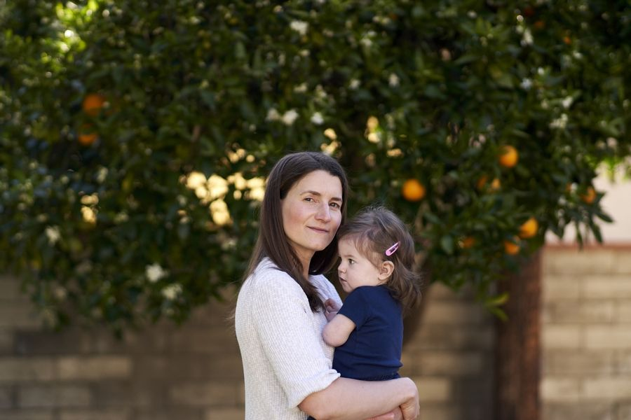 Diana Diller, 39, an event planner, stands with her daughter Simone at their home in Los Angeles. Diller used Ovia to track her pregnancy with Simone.