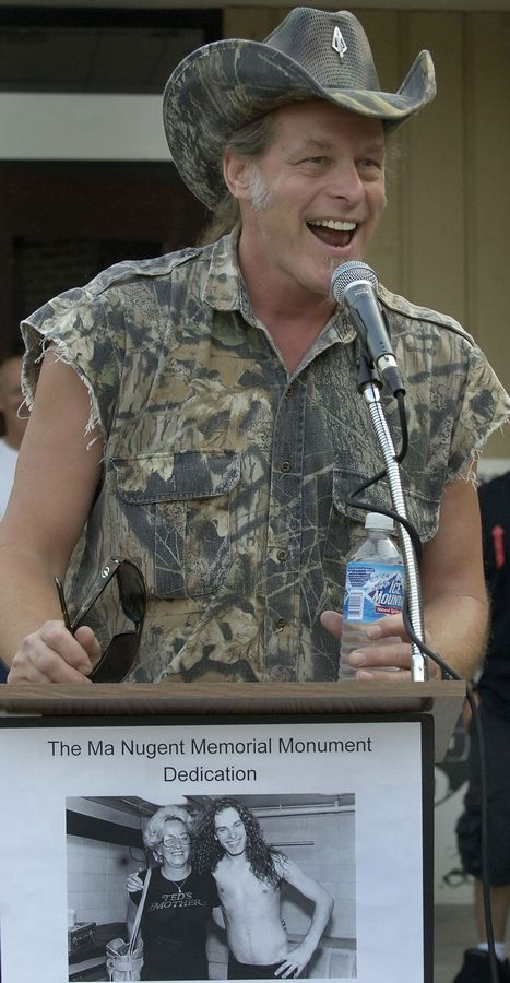 "Ted Nugent lived in Palatine as a teen and graduated from St. Viator High School in Arlington Heights. He is pictured here in 2007 for the dedication of a 7,800-pound rock in honor of his mother, Marion ""Ma"" Nugent, in front of Durty Nellie's in Palatine."
