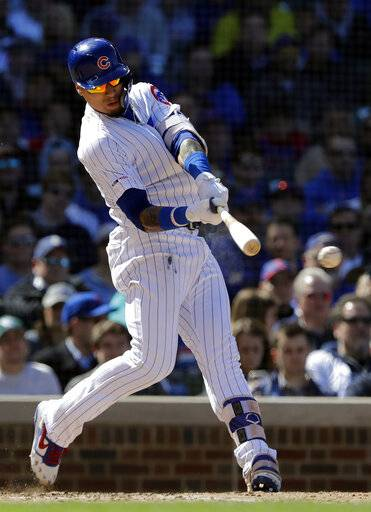 Chicago Cubs' Javier Baez hits an RBI double against the Los Angeles Angels during the fifth inning of a baseball game Saturday, April 13, 2019, in Chicago.