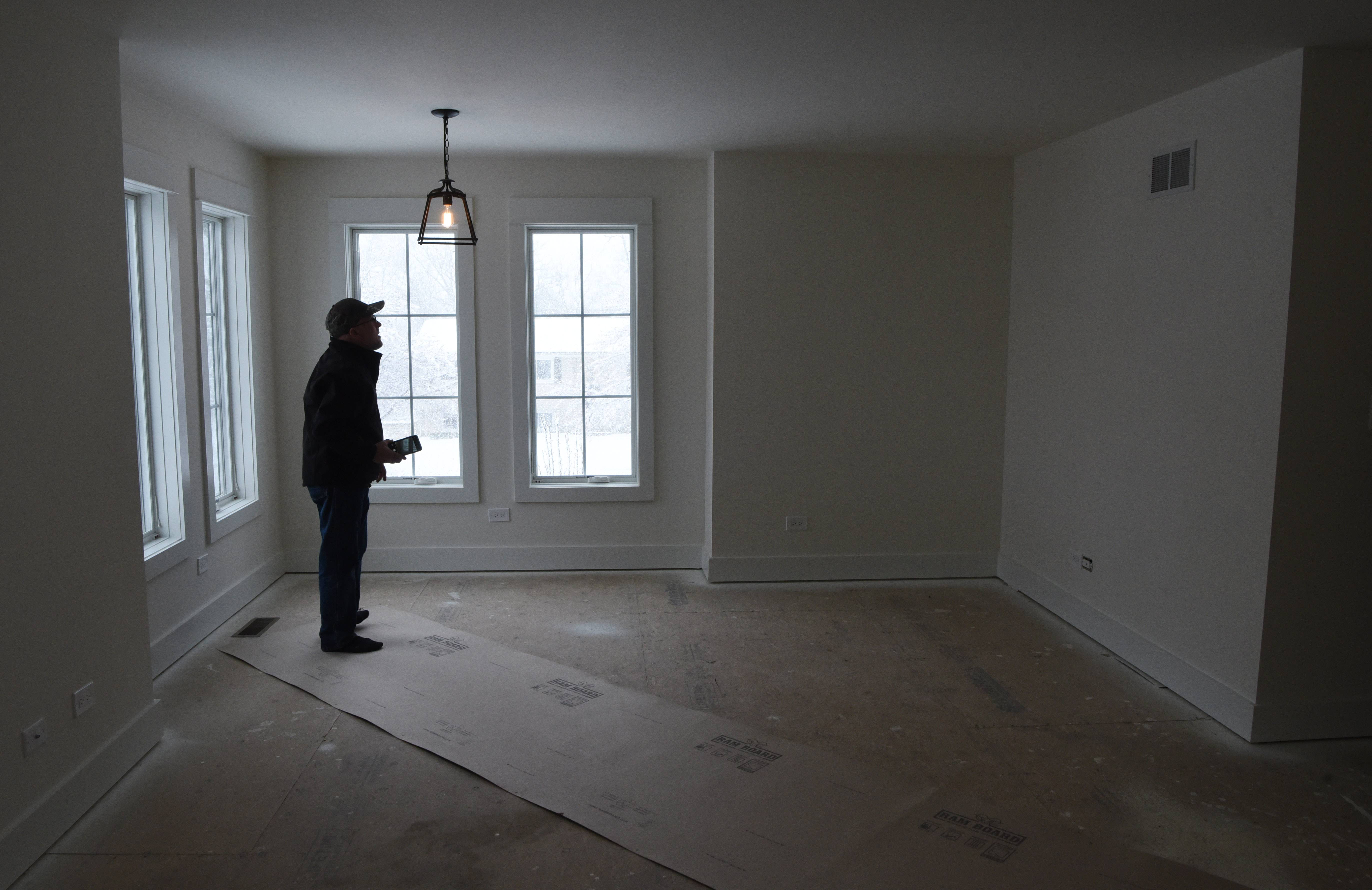 A guest of an open house Sunday views the master bedroom of a home built by Fremd and Palatine high school students.