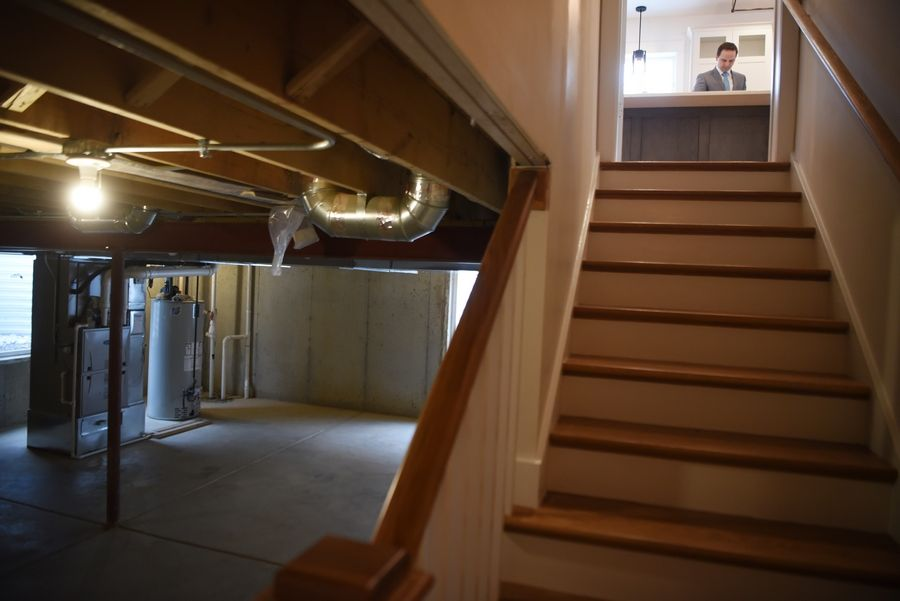 A stairway leads from the kitchen to the basement in a home built by students from a building construction class at Fremd and Palatine high schools.
