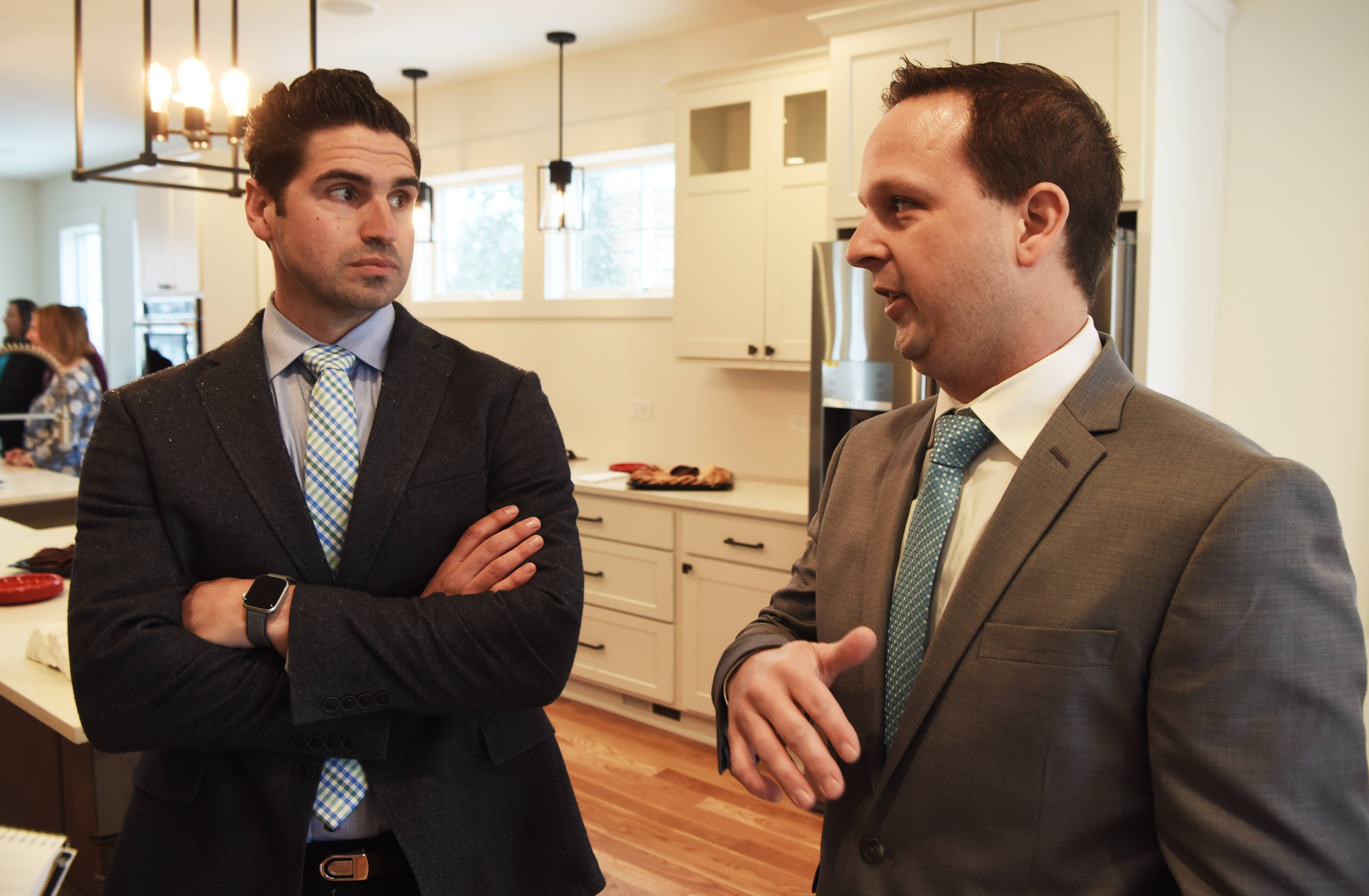 Josh Cattero, left, building construction teacher at Fremd High School, and Chris Gunsteen, who teaches the class at Palatine High School, talk about the home built by their students during an open house Sunday.