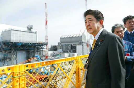 Japanese Prime Minister Shinzo Abe visits Fukushima Dai-ichi nuclear power plant in Okuma, Fukushima prefecture, Japan, Sunday, April 14, 2019,  to inspect the reconstruction effort following the tsunami, quake and nuclear accident in 2011. (Kyodo News via AP)