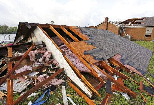 A roof a home that was blown off a home rests on the ground in Hamilton, Miss., after a deadly storm moved through the area Sunday, April 14, 2019.