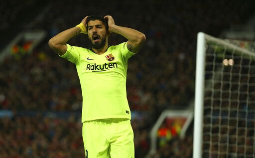 Barcelona's Luis Suarez reacts after missing an opportunity during the Champions League quarterfinal, first leg, soccer match between Manchester United and FC Barcelona at Old Trafford stadium in Manchester, England, Wednesday, April 10, 2019.