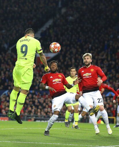 Barcelona's Luis Suarez scores the opening goal of his team during the Champions League quarterfinal, first leg, soccer match between Manchester United and FC Barcelona at Old Trafford stadium in Manchester, England, Wednesday, April 10, 2019.