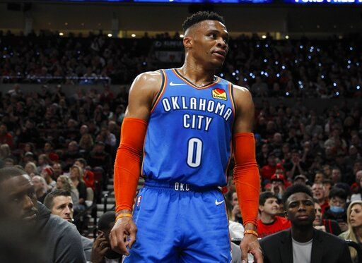 Oklahoma City Thunder guard Russell Westbrook interacts with the crowd during the first half of Game 1 of a first-round NBA basketball playoff series against the Portland Trail Blazers in Portland, Ore., Sunday, April 14, 2019.