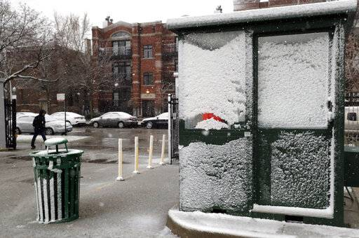 Chicago Cubs parking booth is covered by snow Sunday, April 14, 2019, in Chicago. The Chicago Cubs baseball game against the Los Angeles Angels was postponed due to inclement weather. The makeup date is yet to be determined.