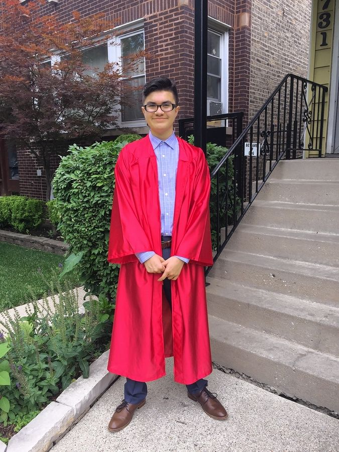 "Matthew ""Mateo"" Garcia, show here at his eighth-grade graduation at age 14, went missing in Lake Michigan in January after jumping in to try to save a friend."