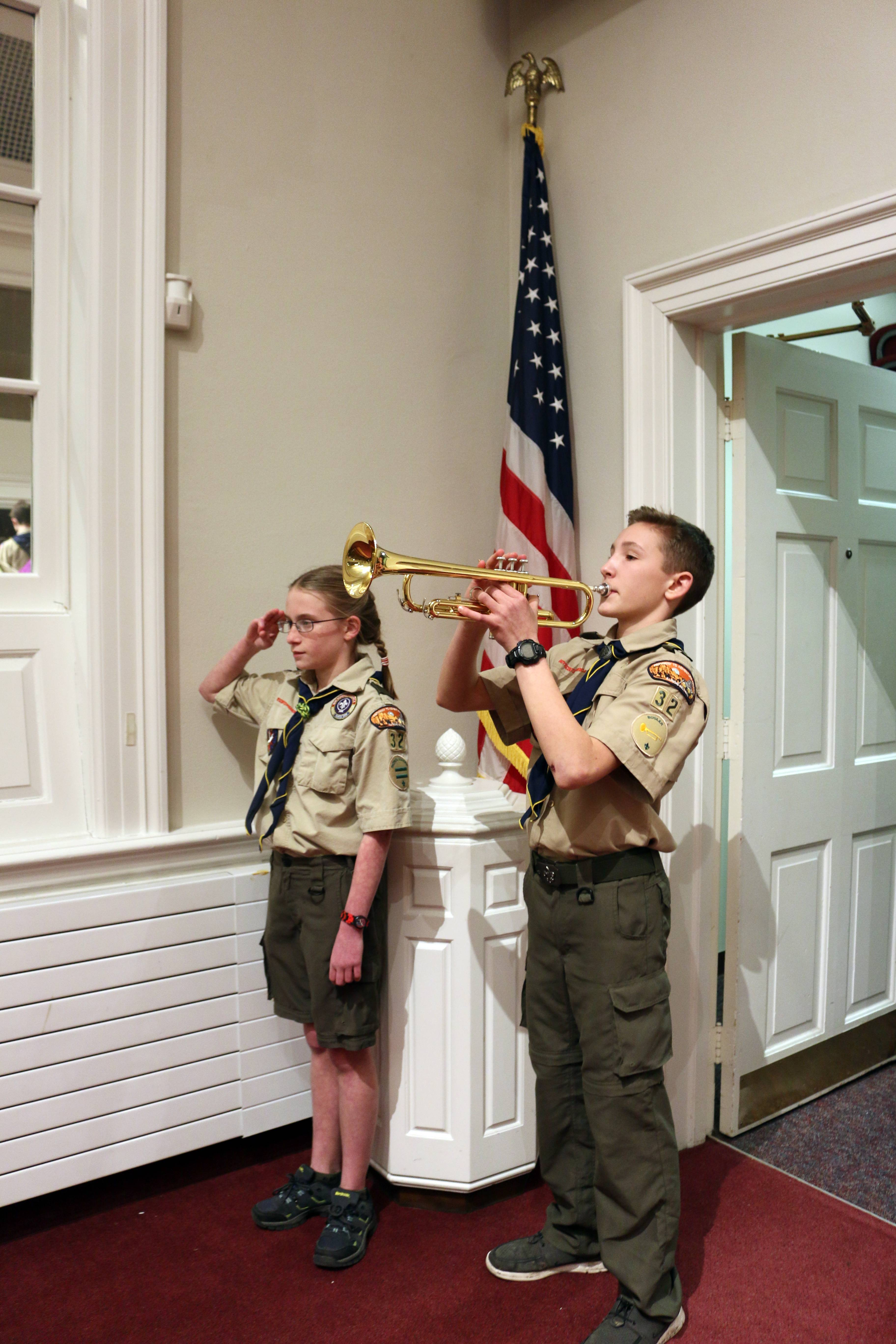 Scouts Madeline Painter and Bill Beck open a recent meeting of Arlington Heights-based Boy Scout Troop 32.