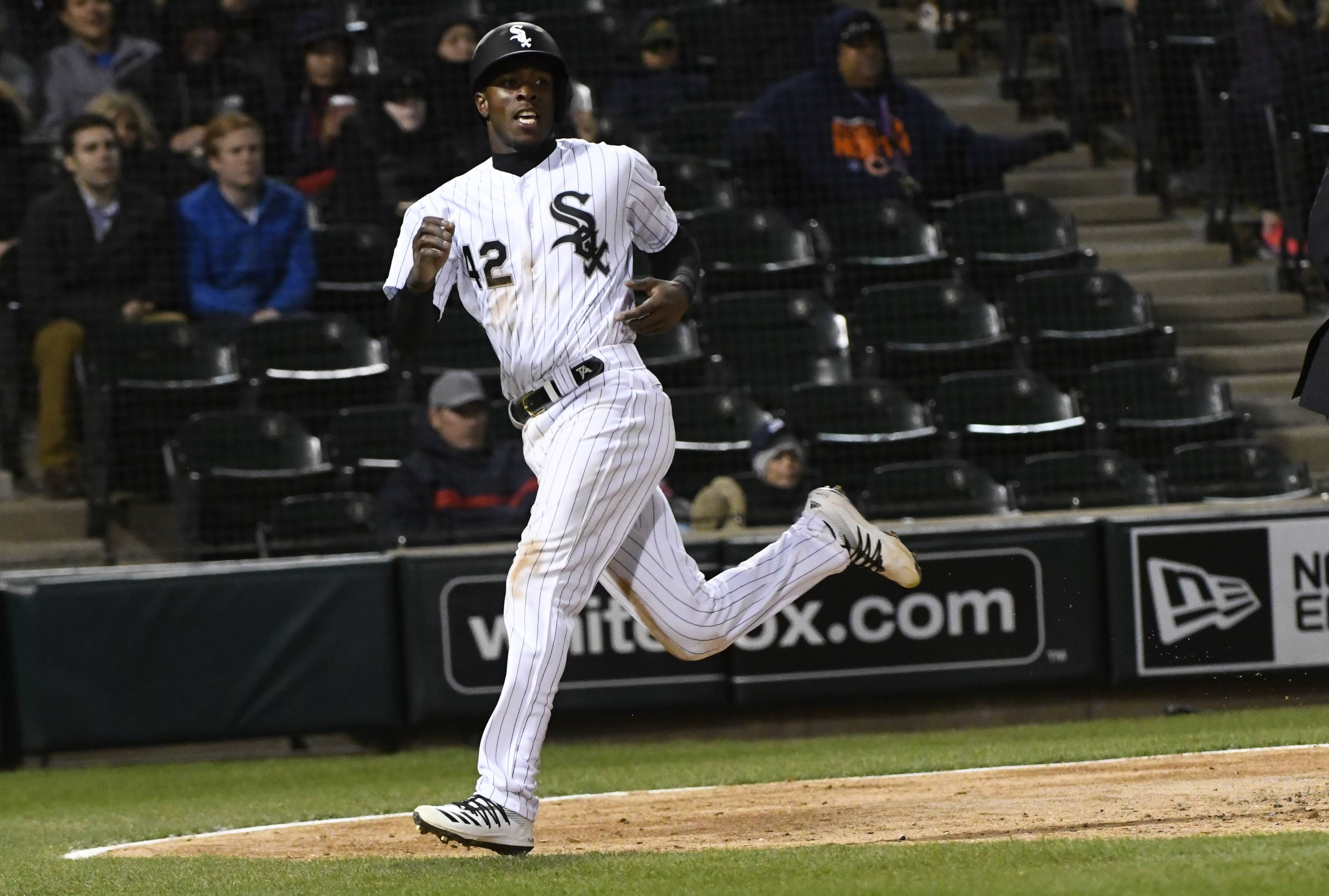 Chicago White Sox's Tim Anderson scores during the fifth inning of a baseball game against the Kansas City Royals, Monday, April 15, 2019, in Chicago.