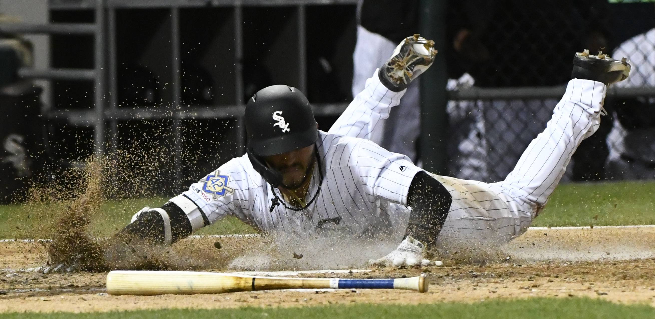 Chicago White Sox's Yolmer Sanchez scores on a double by Leury Garcia during the fifth inning of a baseball game against the Kansas City Royals, Monday, April 15, 2019, in Chicago.