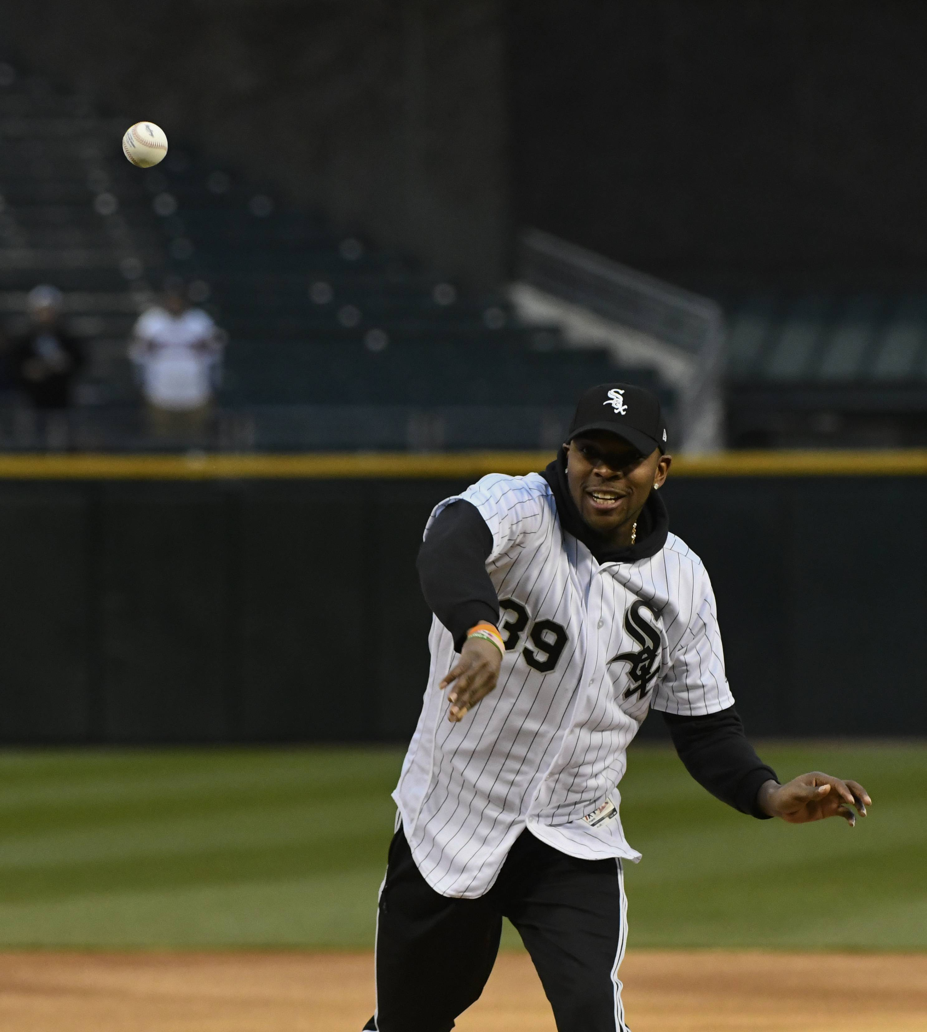 Chicago Bears player Eddie Jackson throws out a ceremonial first pitch before a baseball game between the Chicago White Sox and the Kansas City Royals, Monday, April 15, 2019, in Chicago.