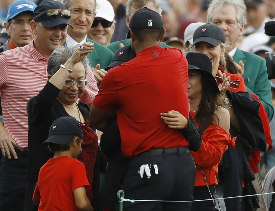 b91d8e97 Tiger Woods hugged his dad after his first Masters win. 22 years later, he  embraced his son.