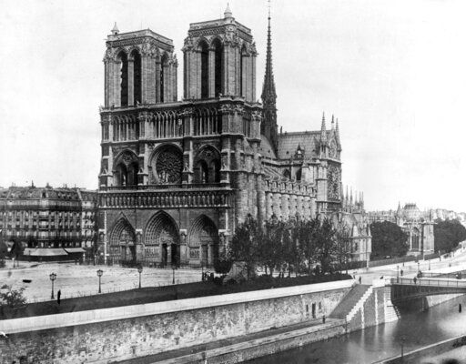 FILE - This 1911, file photo shows the Notre Dame Cathedral, on the island called Ile de la Cite in Paris. Art experts around the world reacted with horror to news of the fire that ravaged cathedral on Monday, April 15, 2019. One shell-shocked art expert is calling the beloved Gothic masterpiece 'one of the great monuments to the best of civilization.'