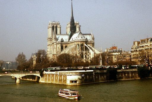 FILE - This 1987 file photo shows the Notre Dame Cathedral in Paris. Art experts around the world reacted with horror to news of the fire that ravaged cathedral on Monday, April 15, 2019. One shell-shocked art expert is calling the beloved Gothic masterpiece 'one of the great monuments to the best of civilization.'
