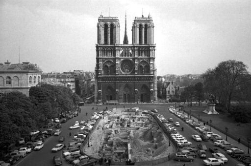 FILE - This April 18, 1967, file photo, shows the Notre Dame Cathedral in Paris. Art experts around the world reacted with horror to news of the fire that ravaged cathedral on Monday, April 15, 2019. One shell-shocked art expert is calling the beloved Gothic masterpiece 'one of the great monuments to the best of civilization.'