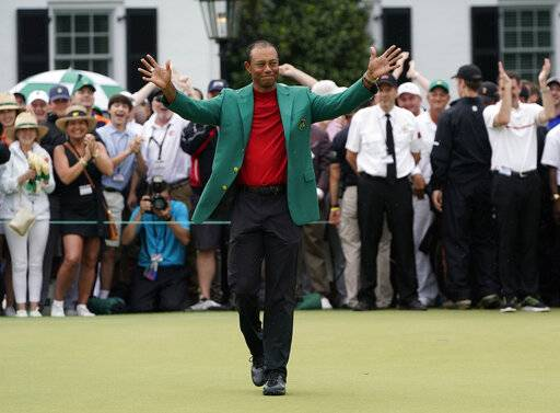Tiger Woods celebrates after he won the Masters golf tournament Sunday, April 14, 2019, in Augusta, Ga.