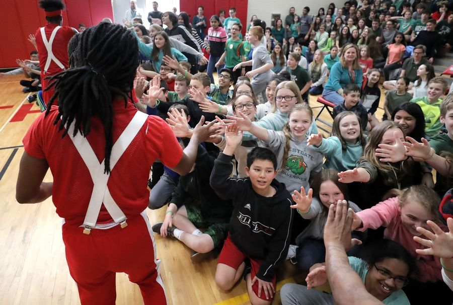 Members of the Jesse White Tumblers high-five South Middle School students Tuesday in Arlington Heights. The group performed during an all-school assembly to promote organ and tissue donation.