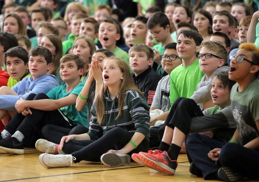 South Middle School students -- many wearing green to promote organ donation -- look in awe Tuesday during a performance by the Jesse White Tumblers in Arlington Heights. One of their classmates, Taylor Petrillo, organized the assembly to honor his 27-year-old brother who was an organ donor.