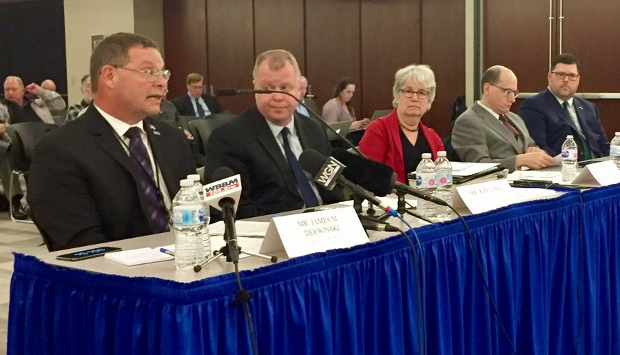 Metra Executive Director Jim Derwinski, from left, Amtrak Senior Director of Government Affairs Ray Lang, BNSF Suburban Services Director Patricia Casler and other railroad officials answer questions at a hearing Tuesday.