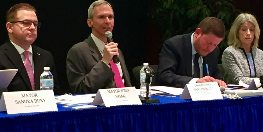Rep. Daniel Lipinski makes a comment Tuesday at a hearing on an Amtrak mishap at Union Station while Bolingbrook Mayor John Noak, a congressional aide, and Willow Springs Mayor Alice Gallagher listen.