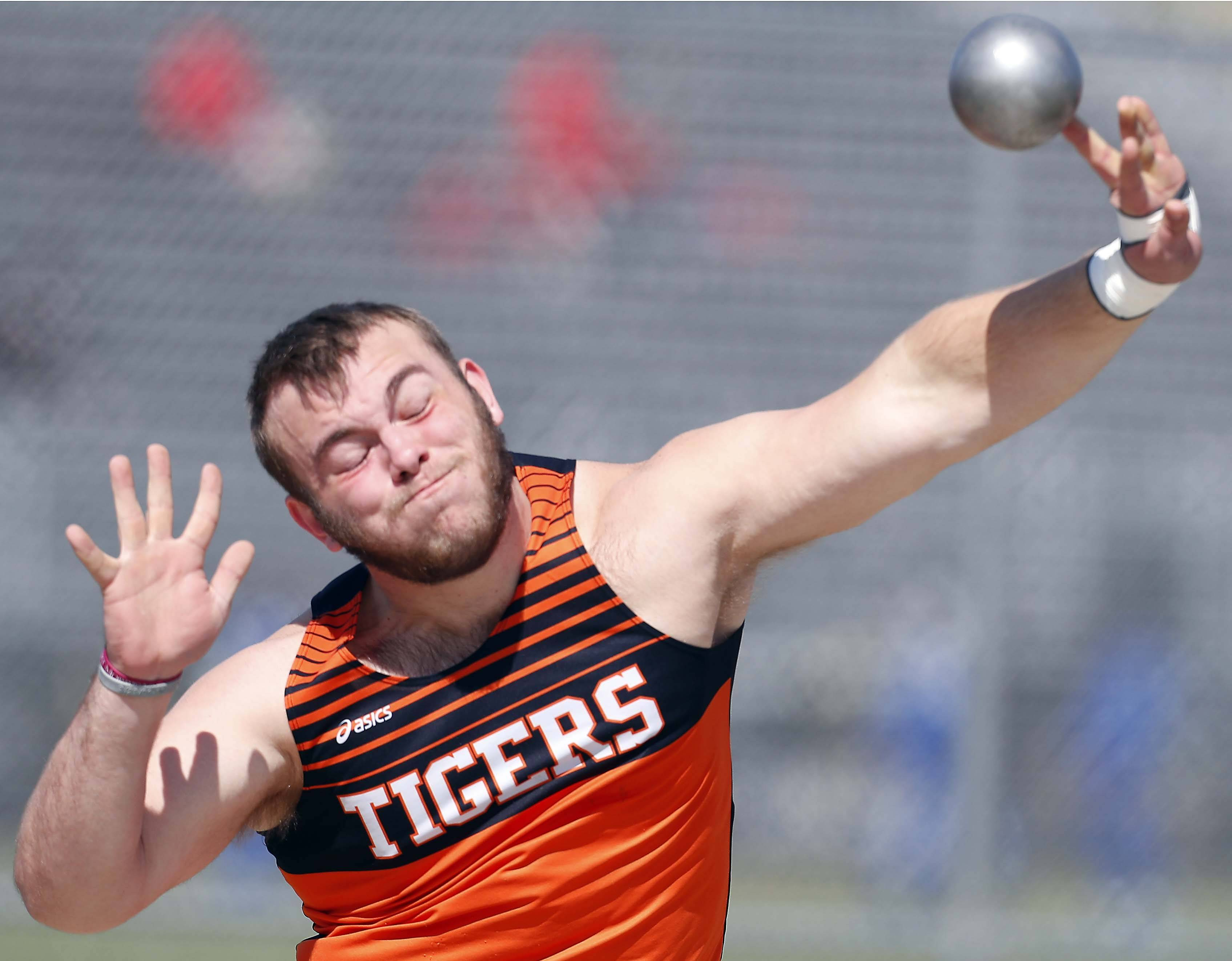Wheaton Warrenville South's Bill Winfrey competes in the shot put Saturday during the Metea Valley boys track invitational in Aurora.