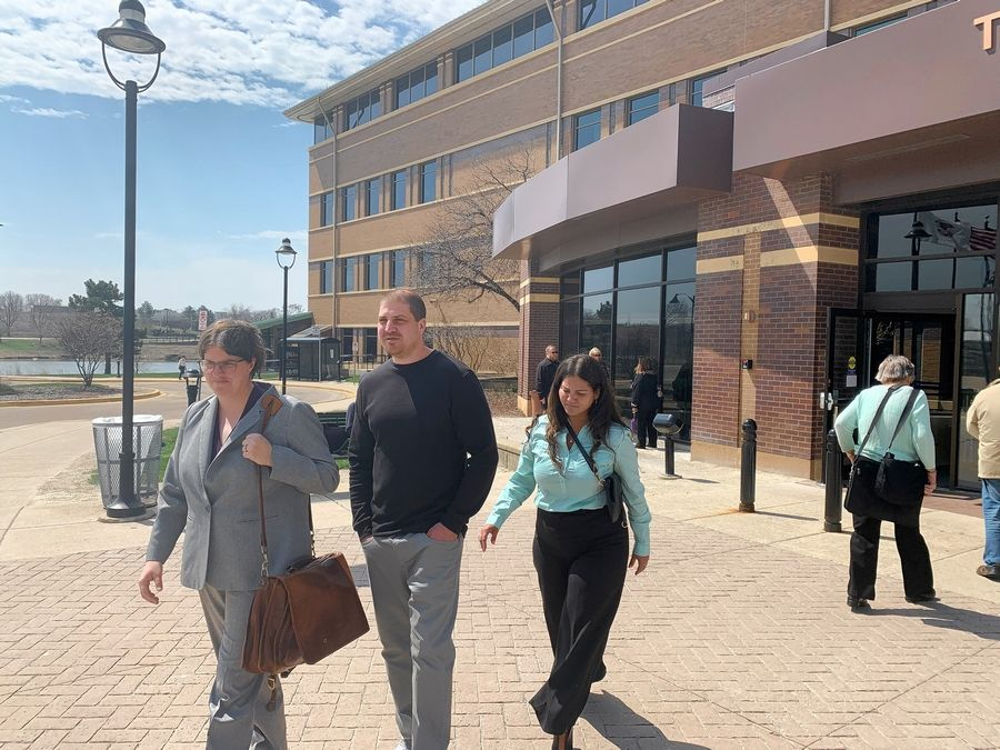 Randy Liebich leaves the DuPage County courthouse Wednesday afternoon with his attorney Tara Thompson, left, after prosecutors dropped 17-year-old murder charges against him.
