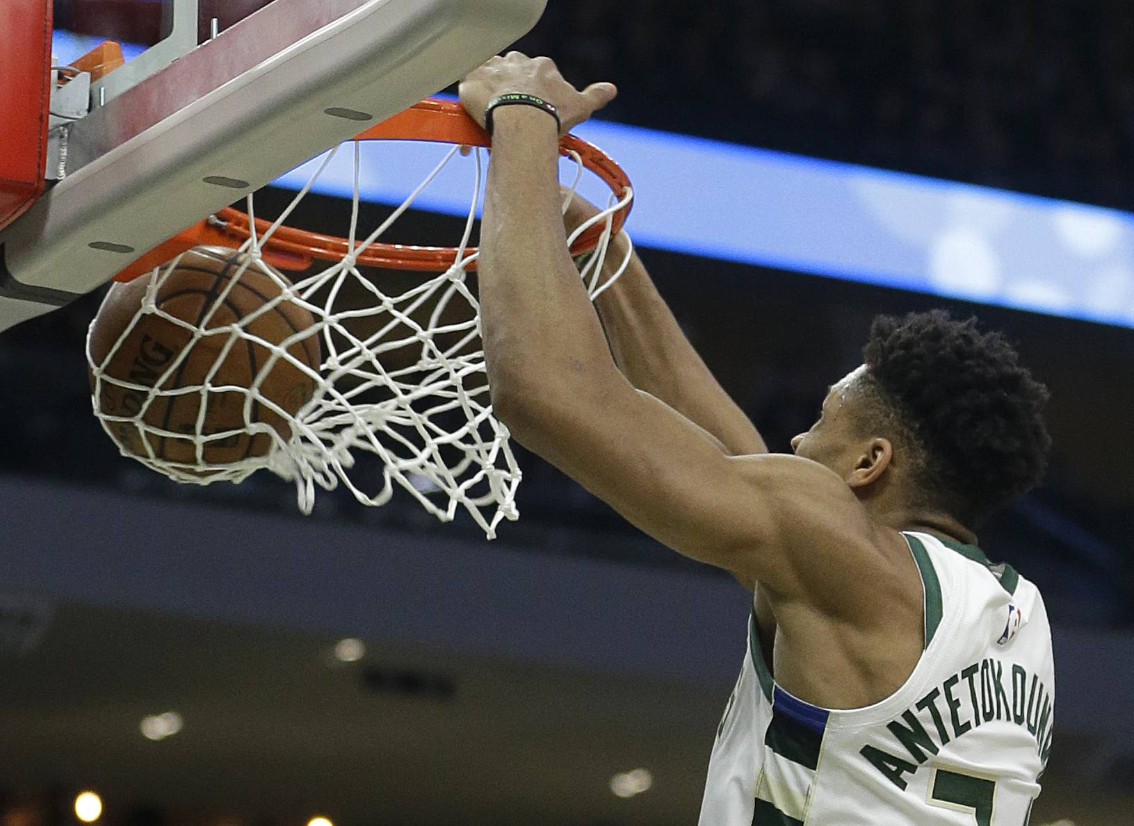 Milwaukee Bucks' Giannis Antetokounmpo dunks during the second half of Game 1 of an NBA basketball first-round playoff series against the Detroit Pistons Sunday in Milwaukee. Antetokounmpo, became the first player to average at least 27 points, 12 rebounds and 5 assists since Kareem Abdul-Jabbar in 1975-76, and is Mike McGraw's pick for MVP.