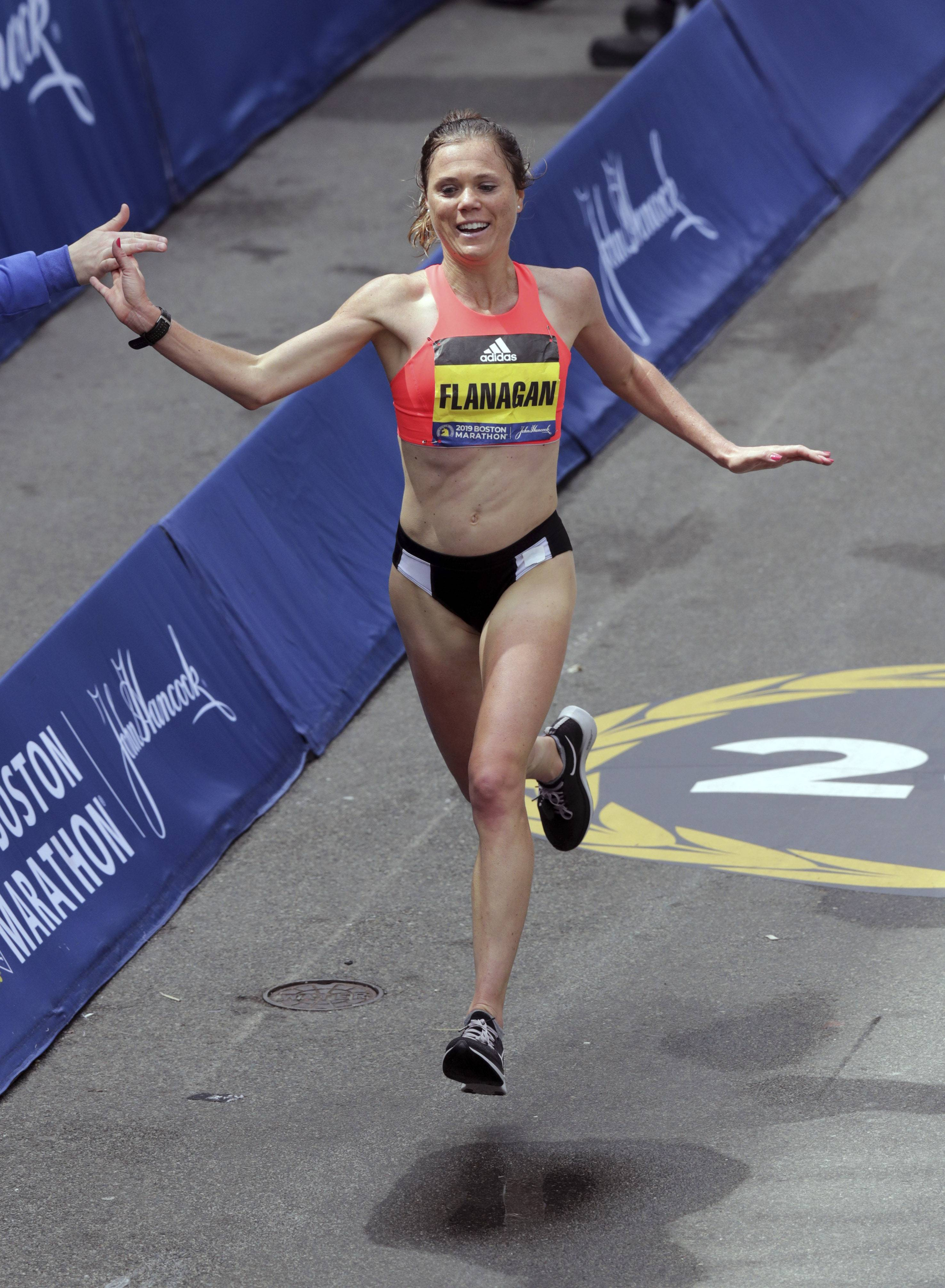 Lindsay Flanagan, of Roselle, Ill., finishes the women's division of the 123rd Boston Marathon on Monday, April 15, 2019, in Boston.