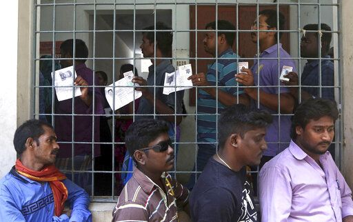 Indians stand in a queue to cast their votes during the second phase of India's general elections in Chennai, India, Thursday, April 18, 2019. The Indian election is taking place in seven phases over six weeks in the country of 1.3 billion people. Some 900 million people are registered to vote for candidates to fill 543 seats in India's lower house of Parliament.