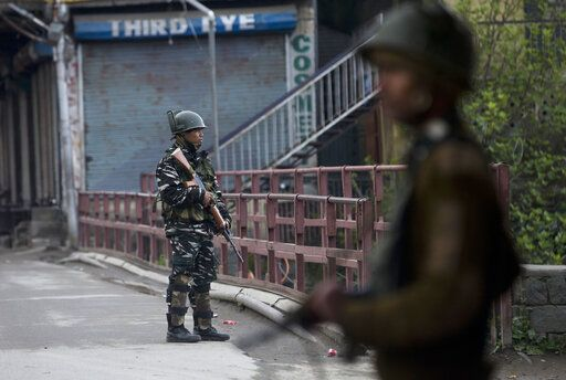 Indian paramilitary soldiers stand guard on a deserted street during the second phase of India's general elections, in Srinagar, Indian controlled Kashmir, Thursday, April 18, 2019. Kashmiri separatist leaders who challenge India's sovereignty over the disputed region have called for a boycott of the vote. Most polling stations in Srinagar and Budgam areas of Kashmir looked deserted in the morning with more armed police, paramilitary soldiers and election staff present than voters.