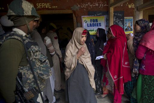 A Kashmiri woman walks out of a polling station after casting her vote during the second phase of India's general elections, in Baba Nagri, about 44 kilometers (28 miles) northeast of Srinagar, Indian controlled Kashmir, Thursday, April 18, 2019. Kashmiri separatist leaders who challenge India's sovereignty over the disputed region have called for a boycott of the vote. Most polling stations in Srinagar and Budgam areas of Kashmir looked deserted in the morning with more armed police, paramilitary soldiers and election staff present than voters.
