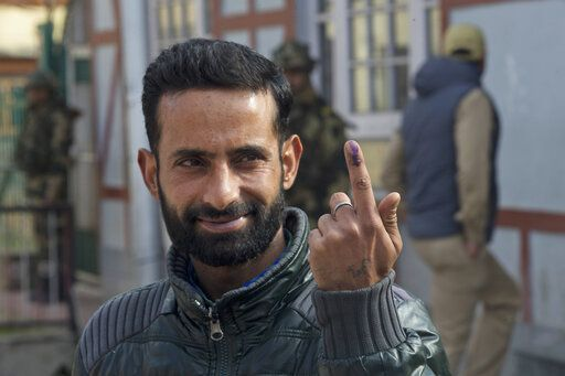 A Kashmiri man displays the indelible ink mark on his index finger after casting his vote, outside a polling booth during the second phase of India's general elections, in Srinagar, Indian controlled Kashmir, Thursday, April 18, 2019. Kashmiri separatist leaders who challenge India's sovereignty over the disputed region have called for a boycott of the vote. Most polling stations in Srinagar and Budgam areas of Kashmir looked deserted in the morning with more armed police, paramilitary soldiers and election staff present than voters.