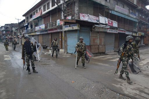 Indian paramilitary soldiers patrol a deserted street during the second phase of India's general elections, in Srinagar, Indian controlled Kashmir, Thursday, April 18, 2019. Kashmiri separatist leaders who challenge India's sovereignty over the disputed region have called for a boycott of the vote. Most polling stations in Srinagar and Budgam areas of Kashmir looked deserted in the morning with more armed police, paramilitary soldiers and election staff present than voters.