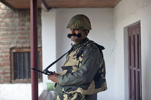An Indian paramilitary soldier stands guard at a polling station during the second phase of India's general elections, in Srinagar, Indian controlled Kashmir, Thursday, April 18, 2019. Kashmiri separatist leaders who challenge India's sovereignty over the disputed region have called for a boycott of the vote. Most polling stations in Srinagar and Budgam areas of Kashmir looked deserted in the morning with more armed police, paramilitary soldiers and election staff present than voters.