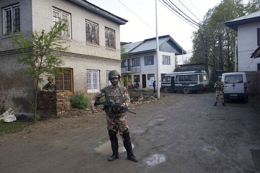 Indian paramilitary soldiers stand guard outside a polling station during the second phase of India's general elections, in Srinagar, Indian controlled Kashmir, Thursday, April 18, 2019. Kashmiri separatist leaders who challenge India's sovereignty over the disputed region have called for a boycott of the vote. Most polling stations in Srinagar and Budgam areas of Kashmir looked deserted in the morning with more armed police, paramilitary soldiers and election staff present than voters.