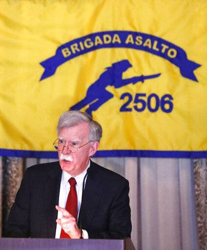 "National security adviser John Bolton gestures while discussing administration new policy during a speech, Wednesday, April 17, 2019, in Coral Gables, Fla., at the Bay of Pigs Veterans Association on the 58th anniversary of the United States' failed 1961 invasion of the island, an attempt to overthrow the Cuban government. The Trump administration on Wednesday intensified its crackdown on Cuba, Nicaragua and Venezuela, rolling back Obama administration policy and announcing new restrictions and sanctions against the three countries whose leaders national security adviser John Bolton dubbed the ""three stooges of socialism."""