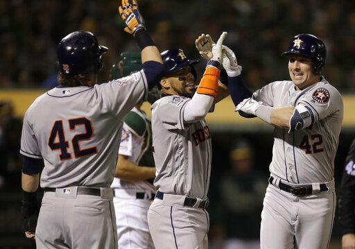 276c0a7ab Houston Astros  Alex Bregman celebrates after hitting a grand slam off Oakland  Athletics relief pitcher