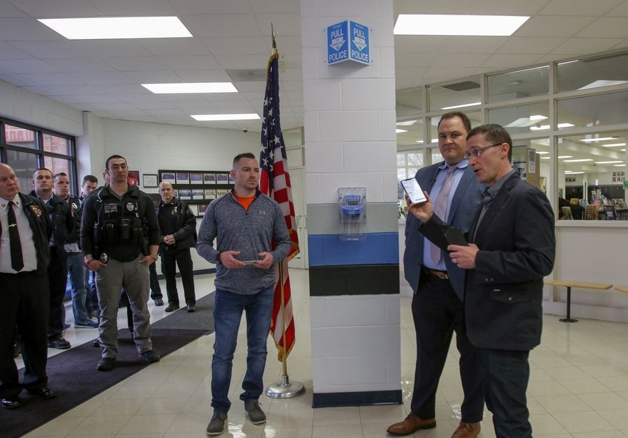 From left, Principal Mike Fumagalli, Superintendent Ted Stec and BluePoint co-founder John Shales explain a new security system Thursday at Glenn Westlake Middle School. Lombard Elementary District 44 implemented the new technology in all eight of its schools.