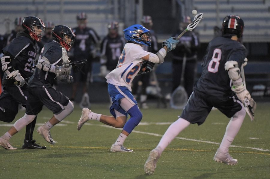 Hoffman Estates' Alex Rodriguez controls the ball as Conant's Michael Paulsen, Kris Tonchev and Alan Hodzic run with him in a boys lacrosse game in Hoffman Estates Thursday.