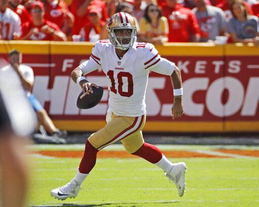 FILE - In this Sept. 23, 2018, file photo, San Francisco 49ers quarterback Jimmy Garoppolo runs with the ball during the first half of the team's NFL football game against the Kansas City Chiefs in Kansas City, Mo. Garoppolo has resumed throwing and taking drop backs as he rehabilitates from a major knee injury that derailed his first full season as San Francisco's starting quarterback. The process of coming back is going smoothly and Garoppolo hopes to be able to take part in seven-on-seven drills when the 49ers begin OTAs next month and be fully cleared by the time training camp starts in late July. (AP Photo/Charlie Riedel, File)