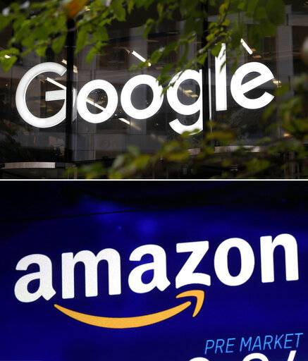 This combo of photo shows the Google logo at their offices in Granary Square, London on Nov. 1, 2018, top, and the Amazon logo on a screen at the Nasdaq MarketSite in New York's Times Square on Oct. 3, 2018, bottom. Amazon and Google are ending their nearly two-year spat, agreeing to bring their video streaming apps to each other's devices. Amazon said Thursday, April 28, that YouTube will appear on Amazon's Fire TV devices and smart TVs in the coming months, but did not give an exact date. (AP Photo)