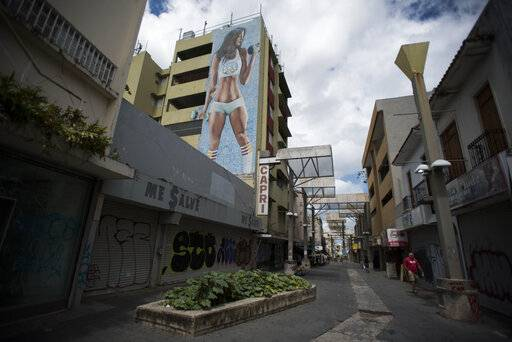 Shops are shuttered in the Paseo de Diego in San Juan, Puerto Rico, Wednesday, April 17, 2019. This central thoroughfare in Rio Piedras was filled years ago with stores that are closed and empty today.
