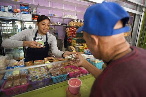 Genesis Perez Martinez, 24, works at the Plaza del Mercado in the Rio Piedras area of San Juan, Puerto Rico, Wednesday, April 17, 2019. The San Juan area has lost 3.9% of its population since Hurricane Maria.
