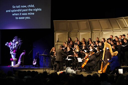 The Colorado Christian University choir performs at a faith-based memorial service for the victims of the massacre at Columbine High School nearly 20 years earlier, at a community church, Thursday, April 18, 2019, in Littleton, Colo. (Rick Wilking/Pool Photo via AP)