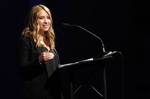 Crystal Woodman-Miller, who was a student at Columbine High School during the massacre nearly 20 years earlier, speaks during a faith-based memorial service for the victims at a community church, Thursday, April 18, 2019, in Littleton, Colo. (Rick Wilking/Pool Photo via AP)